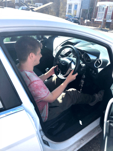 Resident at park road takes care of cars as part of independent living training