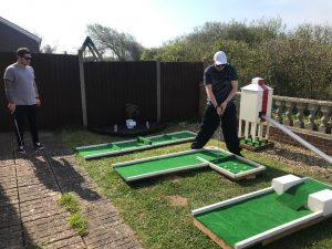 achieving at home with mini golf at our Holly Tree social care service