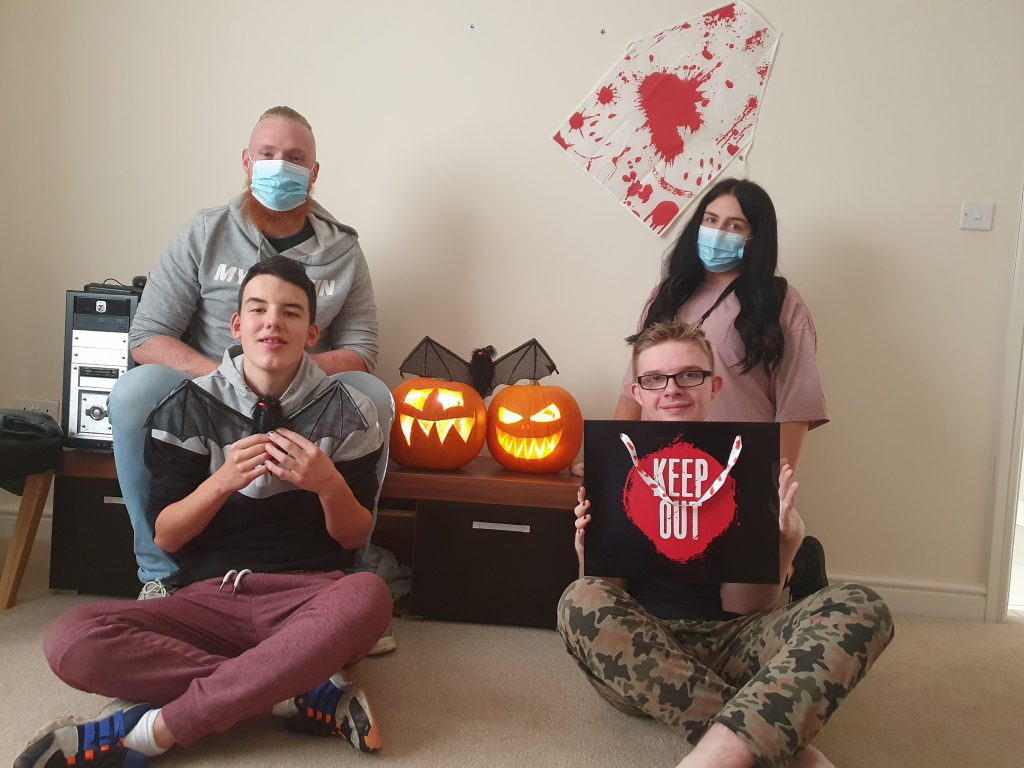 People we support and staff posing with their pumpkins