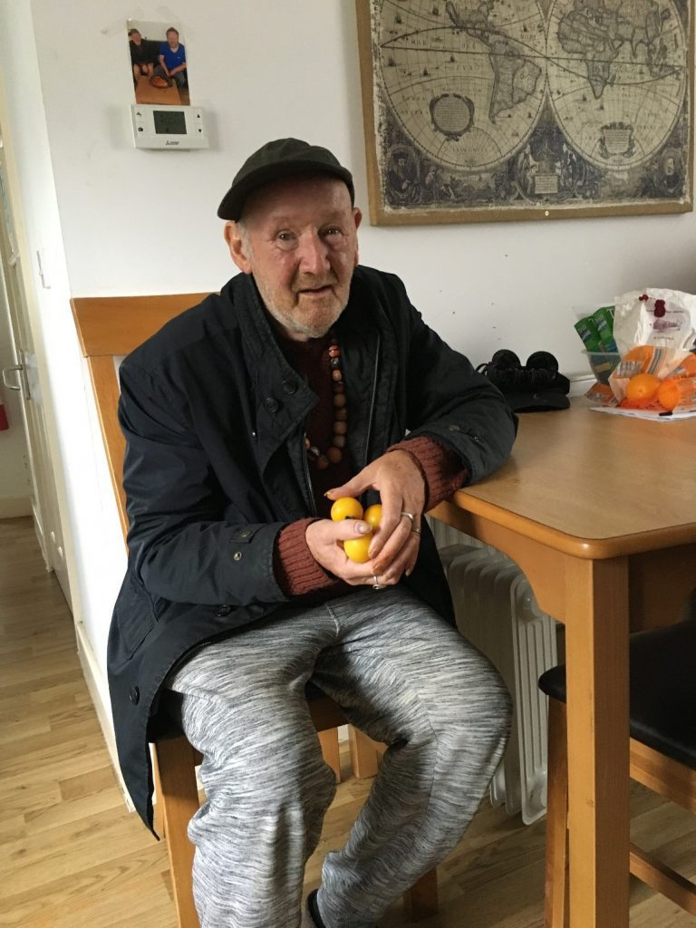 Service user at sail close social care service grows his own tomatoes